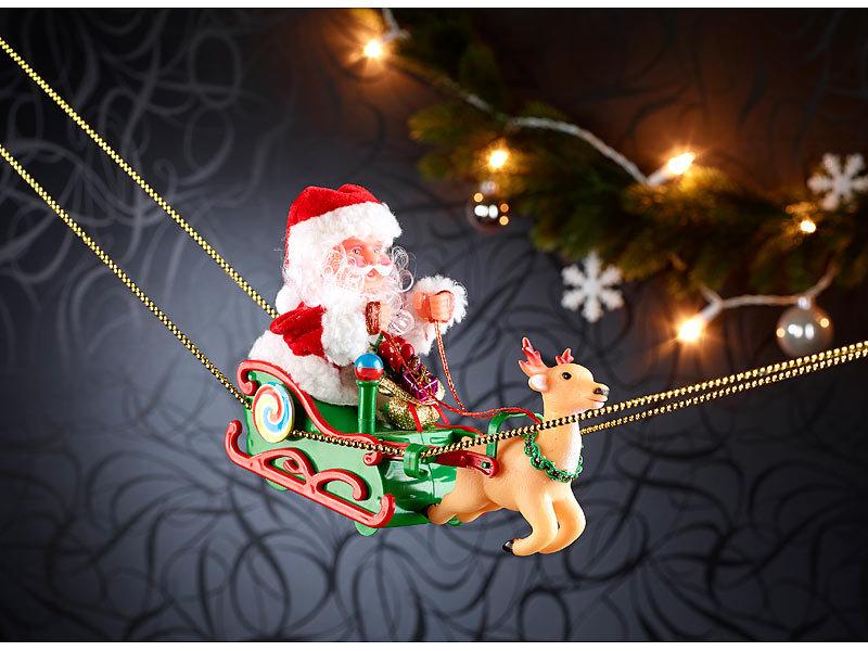 infactory Weihnachtsdeko mit Musik: Weihnachtsmann im schwebenden ...