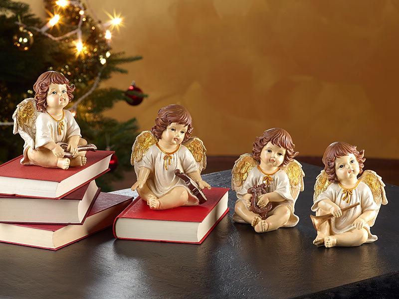 infactory weihnachts fensterdeko deko weihnachtsengel mit musikinstrumenten im 4er set engel. Black Bedroom Furniture Sets. Home Design Ideas