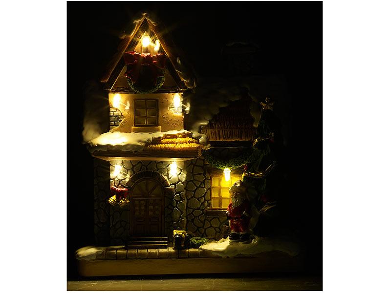 Beleuchtete Weihnachtshäuser